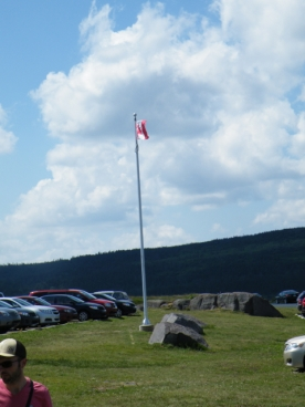 Cape Spear. Not quite one year ago, I took a similar photo of the Canadian flag flying over Vancouver . . .