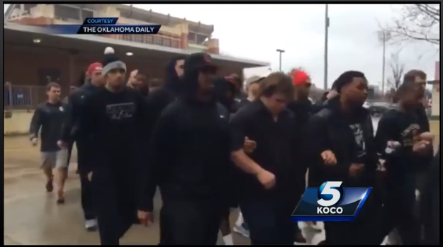 University of Oklahoma football players and coaches march in silent protest on 9 March 2015.